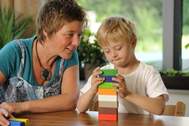 Teacher and pupil with building blocks